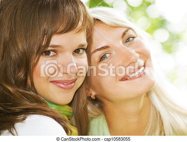 Two beautiful young women outdoors - csp10583055