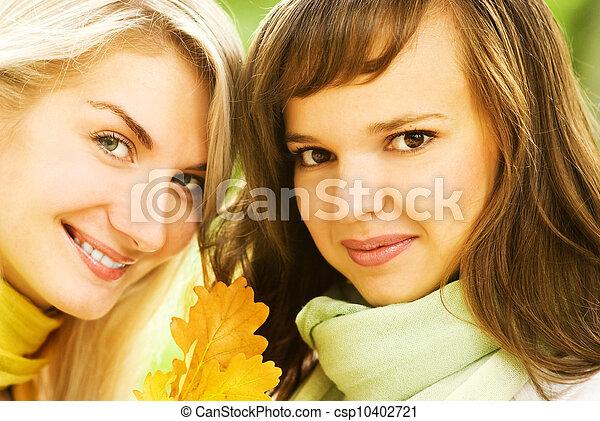 Two beautiful young women outdoors - csp10402721
