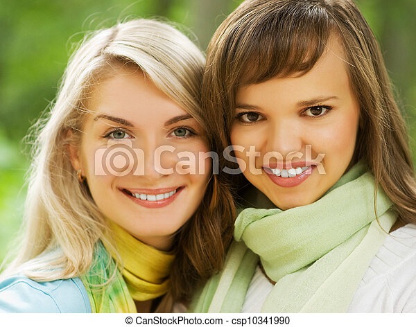 Two beautiful young women outdoors - csp10341990