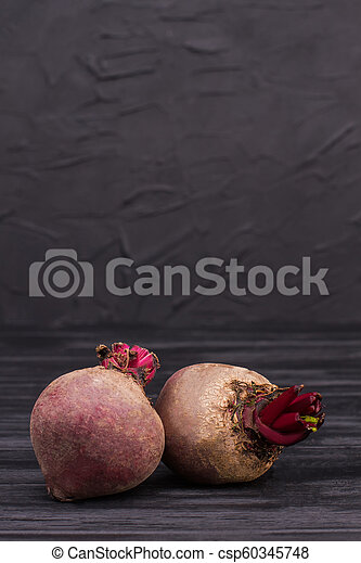 Two beetroots over black background. - csp60345748