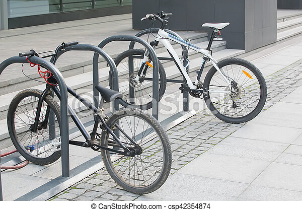 two bikes on the Bicycle parking - csp42354874