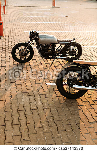 Two black and silver vintage custom motorcycles cafe racers - csp37143370