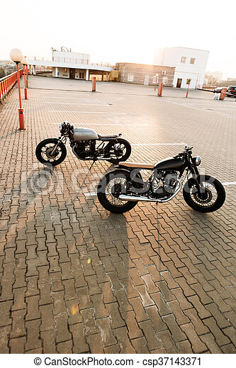 Two black and silver vintage custom motorcycles cafe racers - csp37143371