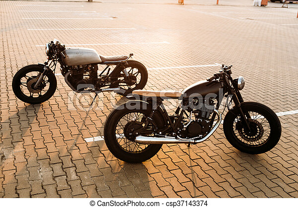 Two black and silver vintage custom motorcycles cafe racers - csp37143374