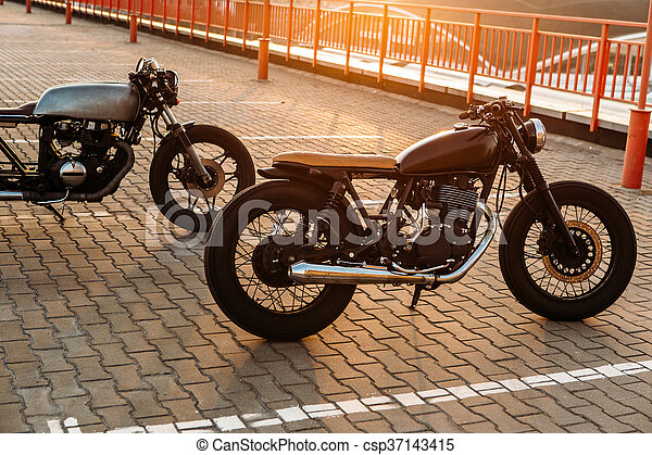 Two black and silver vintage custom motorcycles caferacers - csp37143415
