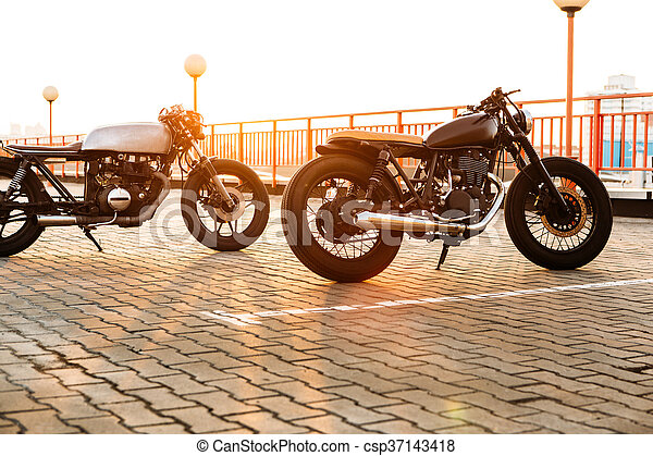 Two black and silver vintage custom motorcycles caferacers - csp37143418