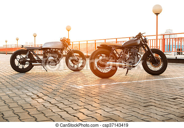 Two black and silver vintage custom motorcycles caferacers - csp37143419