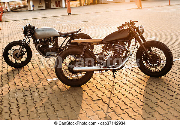 Two black and silver vintage custom motorcycles cafe racers - csp37142934