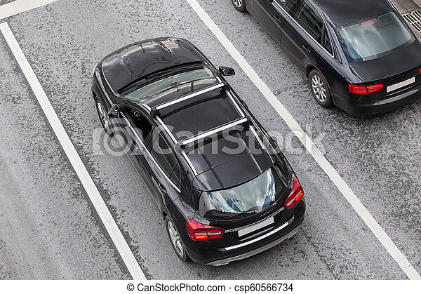 Two Black Cars on the road. - csp60566734