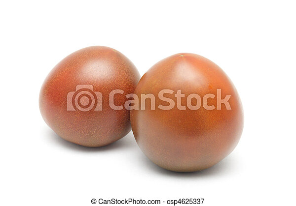 Two Black Prince tomatoes isolated on white background - csp4625337