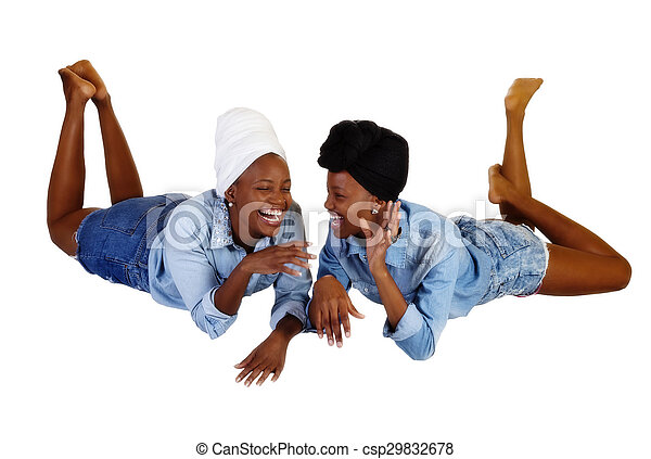 Two Black Sisters Reclining Open Mouth Laugh - csp29832678