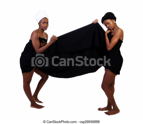 Two Black Sisters Standing Wrapped In Cloth - csp29936888