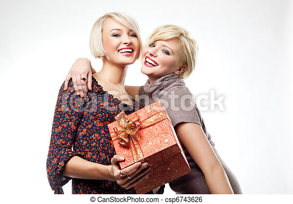 Two blond beauties holding a christmas present - csp6743626