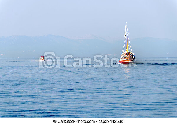 Two boats travelling away - csp29442538