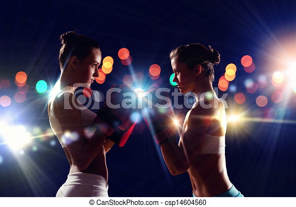 de7fe0664 Two boxer women in gloves greet each other before fight.