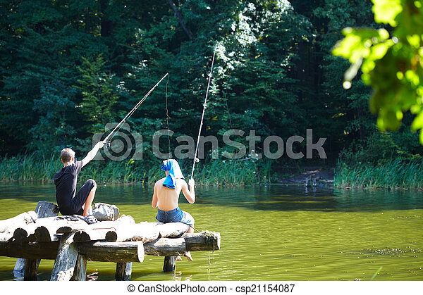 Two boys fishing on the lake - csp21154087