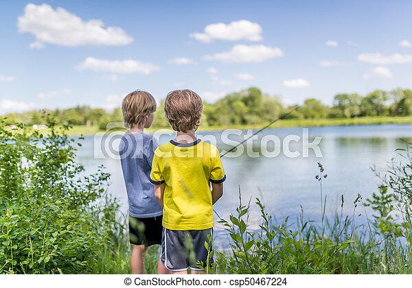 Two boys fishing on the lake - csp50467224