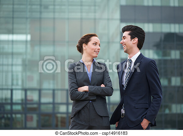 Two business collegues smiling outdoors in the city - csp14916183
