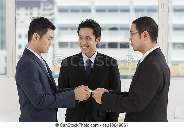 Two business men exchanging business cards - csp18649061