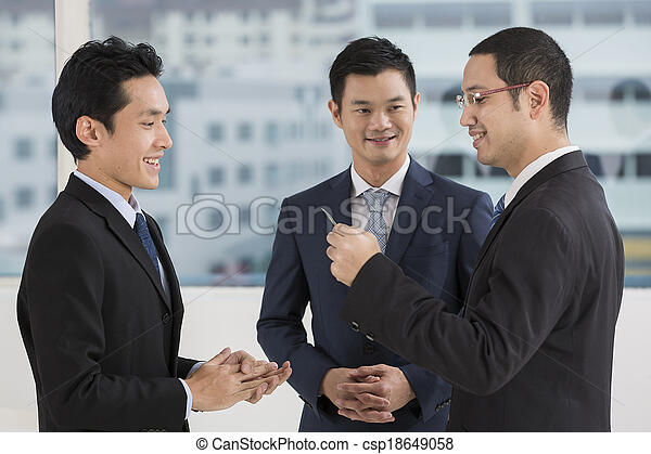 Two business men exchanging business cards - csp18649058