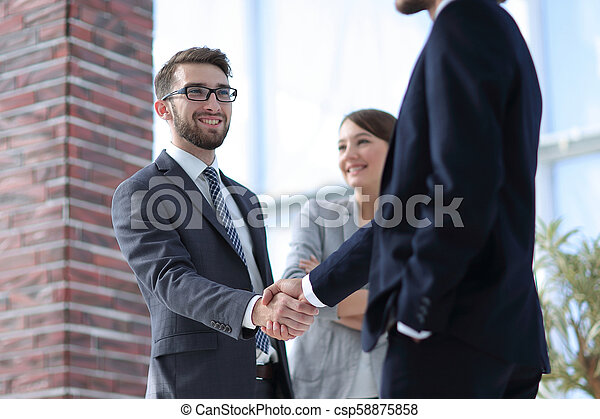 Two Business men shaking hands - csp58875858