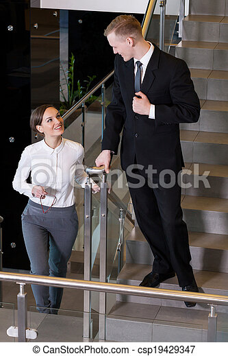 Two business people at office - csp19429347