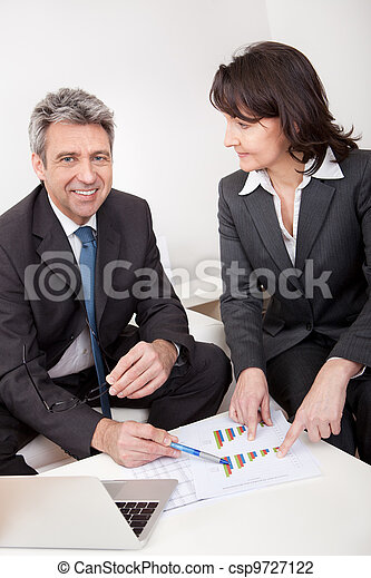 Two business people at the meeting - csp9727122