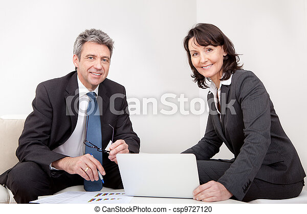 Two business people at the meeting - csp9727120