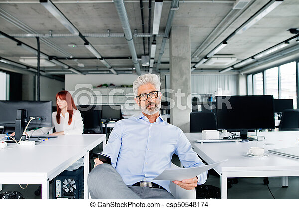 Two business people in the office working. - csp50548174