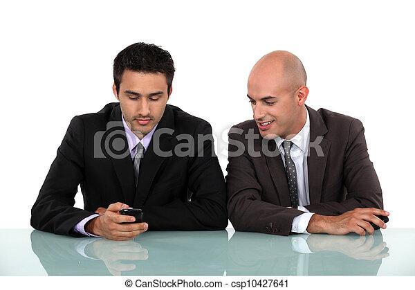 two businessman having a pleasant conversation - csp10427641