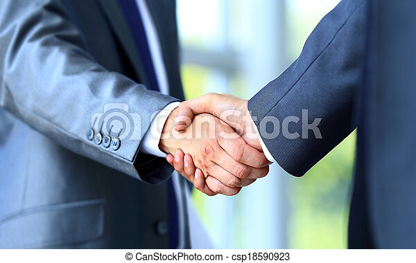 Two businessman shaking hands - csp18590923