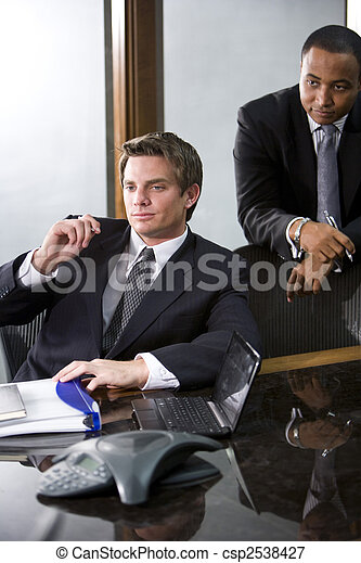 Two businessmen meeting in a boardroom - csp2538427
