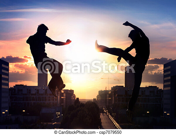 Two capoeira fighters over city background - csp7079550