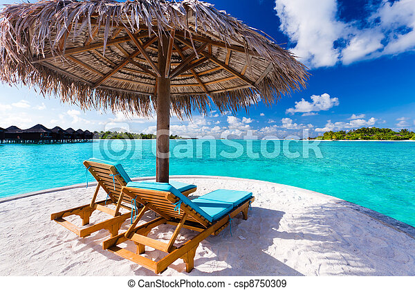 Two chairs and umbrella on tropical beach - csp8750309