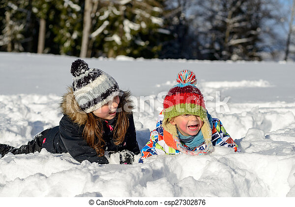 two children in the snow - csp27302876