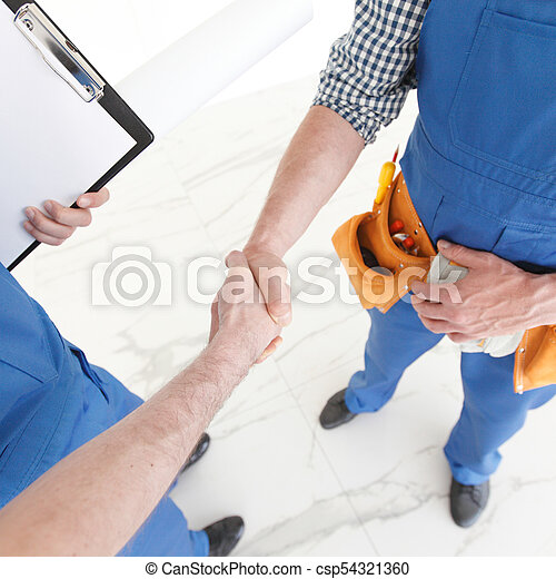 Two construction workers shaking hands - csp54321360