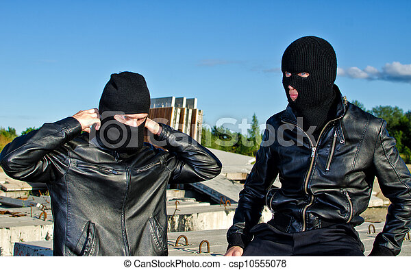 Two criminals getting ready for robbery - csp10555078