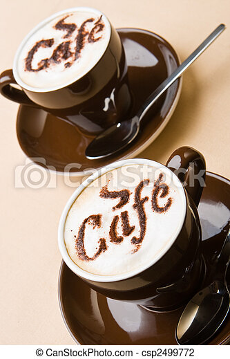 Two cups of fresh cappuccino - csp2499772