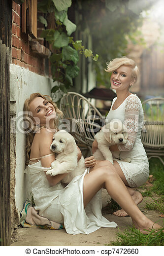 Two cute blondies with puppies - csp7472660
