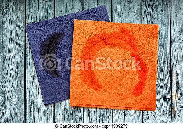 Two dirty blue and orange napkins - csp41339273
