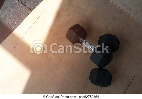 Two dumbbells on the gym floor - csp62782464