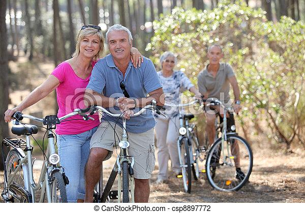 Two elderly couples on bike ride - csp8897772