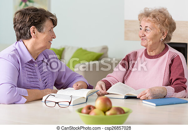 Two elderly women reading - csp26857028