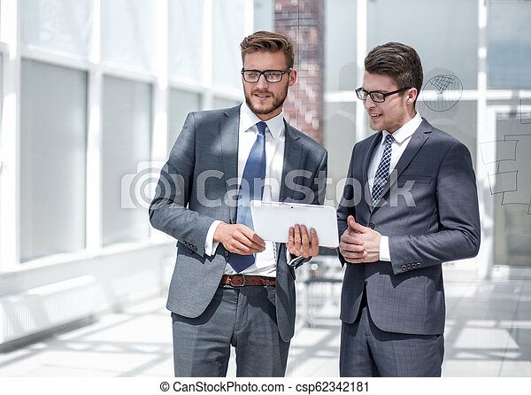 two employees standing in the office - csp62342181