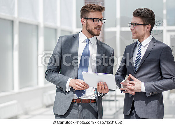 two employees standing in the office - csp71231652