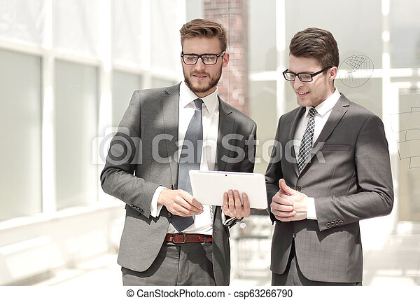 two employees standing in the office - csp63266790