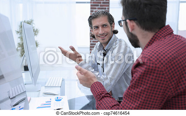 two employees work in the office - csp74616454