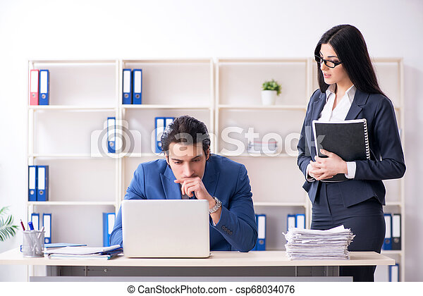 Two employees working in the office - csp68034076