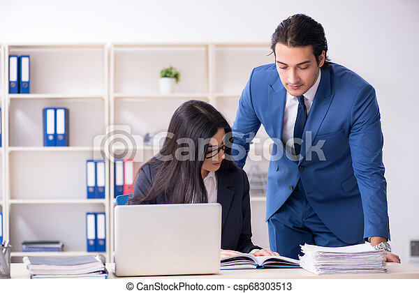 Two employees working in the office - csp68303513