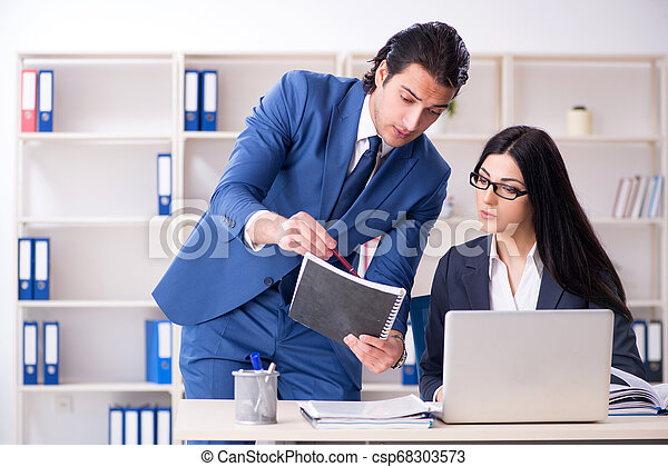 Two employees working in the office - csp68303573